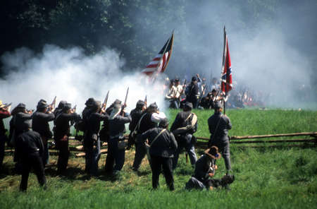 Confederate soldiers advance,Civil War battle reenactment
