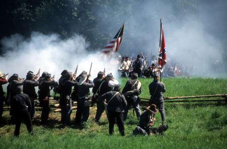 Confederate soldiers advance,  Civil War battle reenactment    Editorial