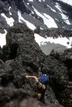 abseil: Climber on Volcanic rocks,   Washington Cascades,  Pacific Northwest