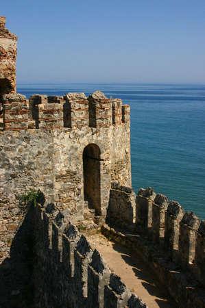 parapet: Mumure Castle - crenellations,embrasures,parapet & merlons Anamur Turkey  Stock Photo