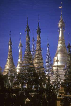 spires: Golden spires of Buddhist stupas in temple,   Shwedagon Pagoda, Rangoon  Yangon, Burma  Myanmar, Asia