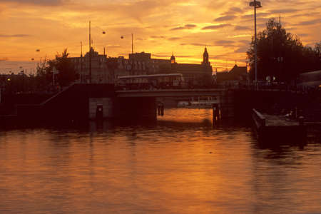 Sunset, bridge and sail boat on canal,Amsterdam,Netherlands