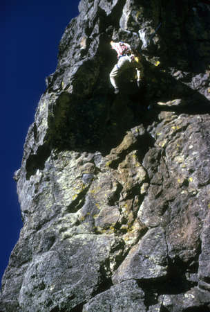 abseil: Rock climber in overhang,   Washington Cascades,  Pacific Northwest Stock Photo