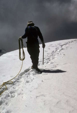 Climber leading rope team on  Paqtsaruru, Cordillera Blanca Peru, South America  photo