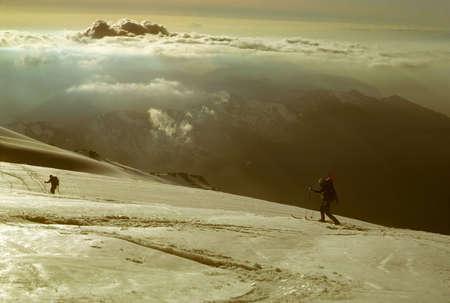Telemark skiers on ascent of Mt Baker, near sunset,  Cascades Washington  Фото со стока