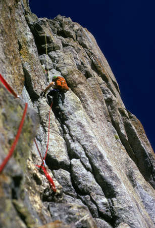 belay: Climber on face of Pingora, Cirque of the Towers  Wind Rivers Range of Rocky Mountains Wyoming  Stock Photo