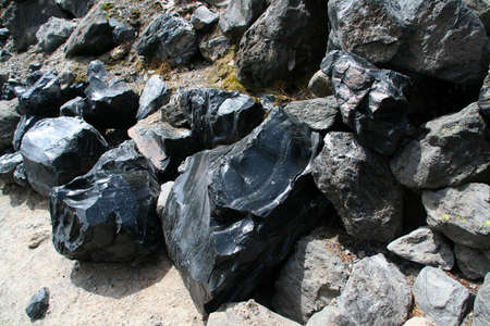 igneous: Obsidian boulders from lava flow, volcanic eruption,  Newberry National Volcanic Monument, Central Oregon