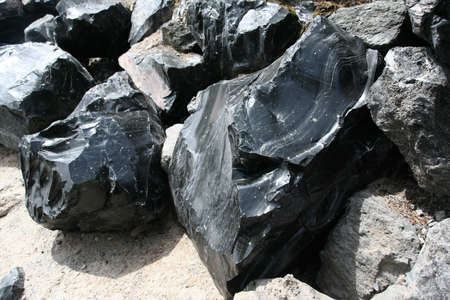Obsidian boulders from lava flow, volcanic eruption,		Newberry National Volcanic Monument,	Central Oregon