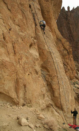 Woman belaying a climber on rock face,  Smith Rock State Park,  Central Oregon