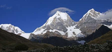 lenticular: Panorama -  Cordillera Huayhuash, Yerupaja with lenticular clouds forming,   Peru, South America Stock Photo