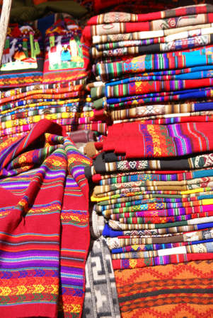 quechua: Colorful handmade blankets and tablecloths, Pisac market,  Cusco, Peru, South America Stock Photo