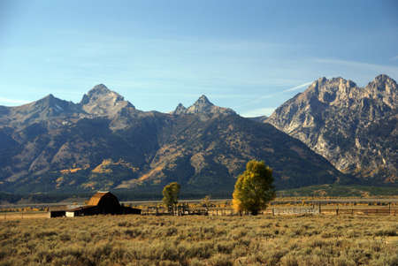 Western buildings with Tetons in background, Antelope Flats, Grand Teton National Park,Wyoming Archivio Fotografico