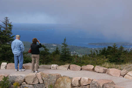 Tourists on top of Cadillac Mountain looking over Bar Harbor,   Cadillac Mountain, Mount Desert Island, Acadia National park, Maine, New England Stock Photo