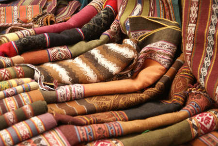 quechua: Colorful handmade blankets & tablecloths, Pisac market,  Cusco, Peru, South America