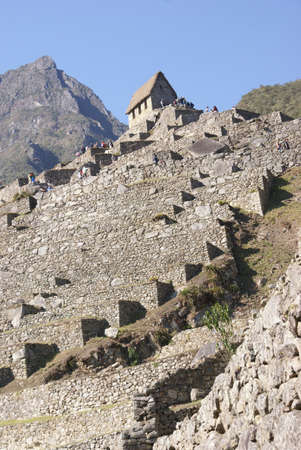 Terraced fields and guardian huts,  Inca ruins  Machu Picchu, Peru, South America