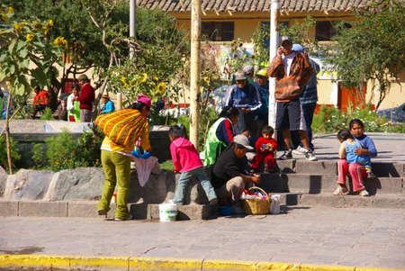 serape: OLLANTAYTAMBO PERU 29 AUG 2008 - Quechua Indians  waiting for a bus,  Ollantaytambo,  Peru, South America Editorial