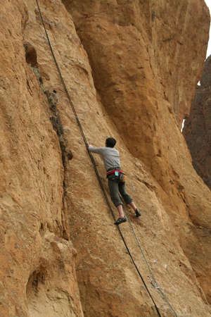 Climber on sheer rock face,  Smith Rock State Park,  Central Oregon