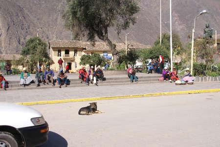 quechua: OLLANTAYTAMBO PERU 29 AUG 2008 - Quechua Indians  waiting for a bus,  Ollantaytambo,  Peru, South America Editorial