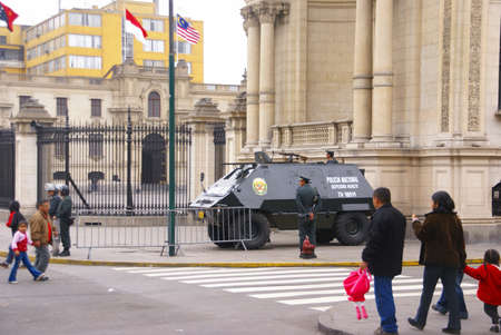 LIMA PERU 30 AUG 2008 -  Riot police stand ready near armored car during parade.