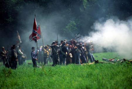 civil war: SEATTLE - JUL 10 - Union artillery fires their gun in a Civil War battle reenactment on July 10, 1996 near Seattle.