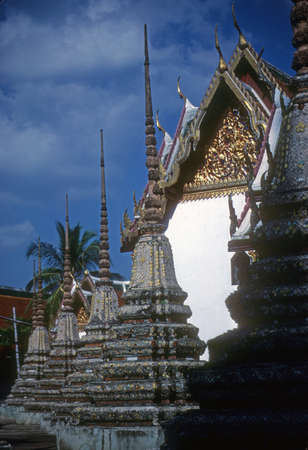 Elaborate temple spires of Buddhist temple in Bangkok,Thailand, Asia