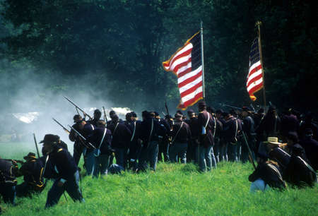 battle: SEATTLE - JUL 10 - Union infantry line fires on advancing  Confederate soldiers, during a Civil War battle reenactment on July 10, 1996 near Seattle.