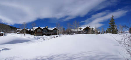 Panorama: rolling hills, conifers and large homes,  Cordillera, Colorado