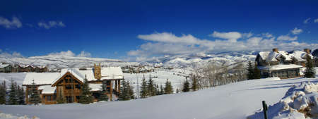 Panorama: rolling hills in winter, conifers and large homes,  Cordillera, Colorado