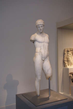 Statue of naked young man, armless,  Roman & Greek galleries, Metropolitan Museum of Art, New York CityNY DSC Stock Photo - 11654560