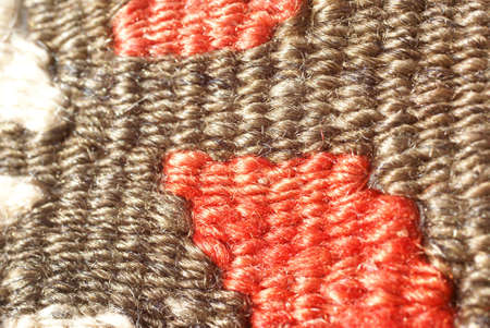 Detail, tightly woven knots of vintage Turkish kilim      photo