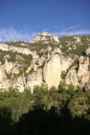 Limestone cliffs and forest  near the town of  Entraygues, France Stock fotó - 11752038