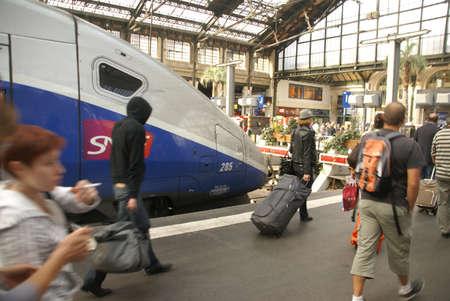 arrive: PARIS - OCT 3 - Passengers arrive at the Gare de Lyon railway station,  on Oct 3, 2011, in Paris, France.