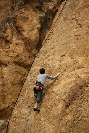 Climber on sheer rock face,  Smith Rock State Park,  Central Oregon  photo