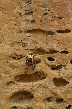 Rock climber on potholes route,Smith Rock State Park, Central Oregon Фото со стока - 11752220