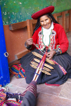 Quechua Indian woman weaving with strap loom,   Cusco, Peru, South America
