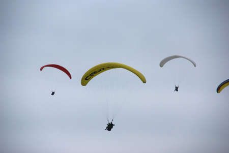 parapente: Paragliders soaring on overcast day,  Lima, Peru, South America