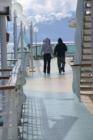 brisk: Young couple holding hands on brisk morning on cruise ship deck,  Juneau, Alaska
