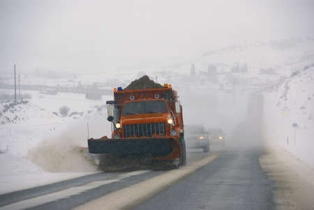 snow plow: Snowplow clearing streets after heavy snowfall,  Steamboat Springs, Colorado, Rocky Mountains  Editorial