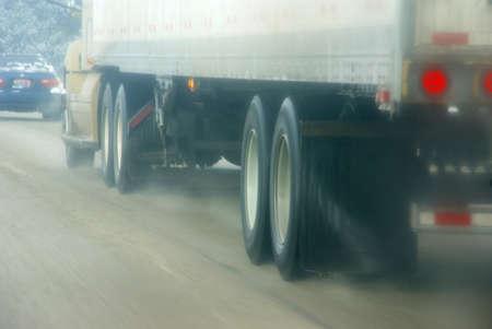 oregon cascades: Trucks speeding through snow storm,   Oregon Cascades