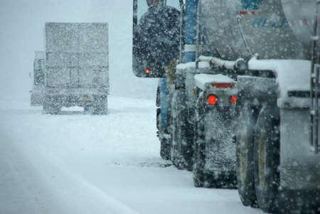 Trucks on winter highway during snowstorm,   Oregon, Pacific Northwest