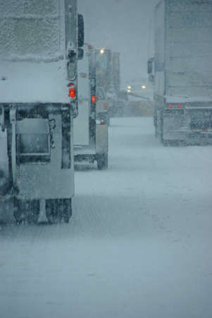 winter road: Trucks on winter highway during snowstorm,   Oregon, Pacific Northwest