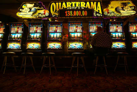 Lone man playing video slot machines,Cruise ship casino,Pacific Northwest Editoriali