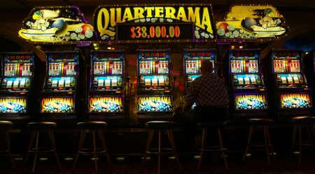 machine: Lone man playing video slot machines, Cruise ship casino,  Pacific Northwest