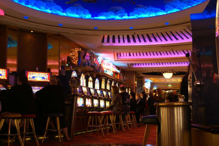 casino dealer: INSIDE PASSAGE, ALASKA 27 Jun 2008 -  The Casino with slot machines, roulette and card games lures gamblers after dinner on a cruise ship  Pacific Northwest