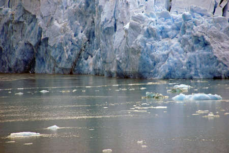 sawyer: Glacier dropping into ocean, Sawyer Glacier, Endicott Arm Fjord, Alaska Stock Photo