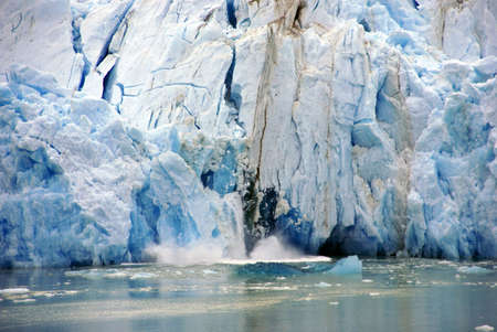 calving: Glacier calving,Sawyer Glacier, Endicott Arm Fjord, Alaska  Stock Photo