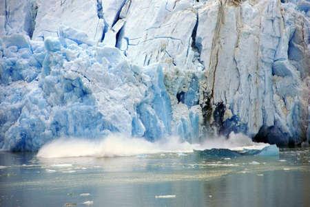Glacier calving,Sawyer Glacier, Endicott Arm Fjord, Alaska  Фото со стока