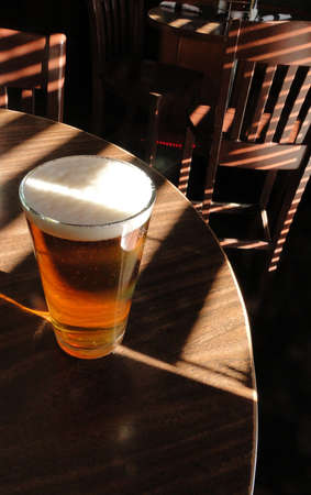 ipa: Pint of ale on a tavern table in Steamboat Springs, Colorado