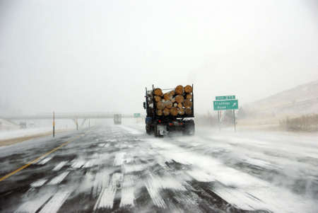 logging truck: Logging truck on icy road  during winter storm in Eastern Oregon