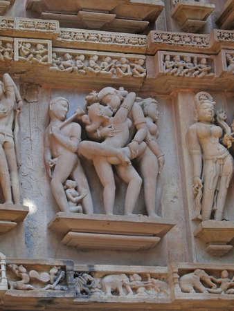 kama: Sculptures of loving couples, illustrating the Kama Sutra, on walls of  Varaha Temple, Khajuraho in  India, Asia